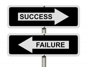 Success versus Failure Black and white street signs with words Success and Failure isolated on white